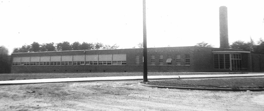 Black and white photograph of Drew-Smith Elementary School. The building is a single-story concrete structure with a brick veneer. It had much fewer classrooms and fewer amenities than the schools built for white children during this time period.