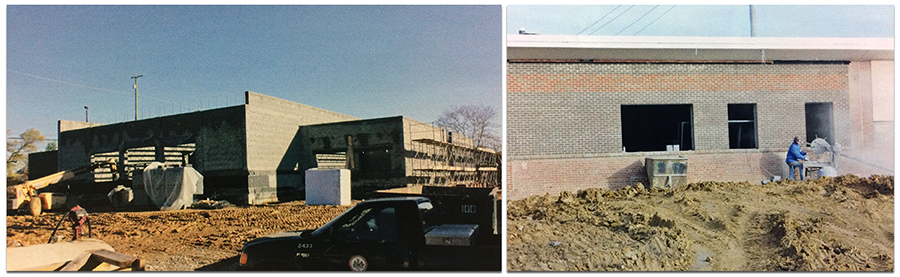 Two color photographs from Garfield's 2013 yearbook showing construction on the new wing of the building. The photograph on the left shows the cinderblock walls that have been erected, but there is still no roof on the structure. Construction equipment and vehicles are stationed around the building. The photograph on the right shows a construction worker cutting bricks to fit around a window frame. The brick veneer on the outside of the building is in place, as is the roof.